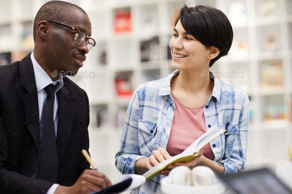 Cheerful girl presenting project to investor - Stock Photo - Images