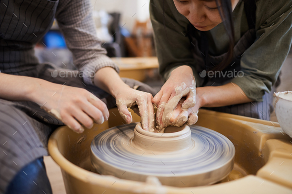 Showing how to mould clay dish - Stock Photo - Images