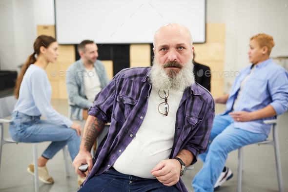 Tough Bearded Man in Therapy Session - Stock Photo - Images