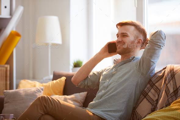 Handsome Man Speaking by Phone at Home - Stock Photo - Images