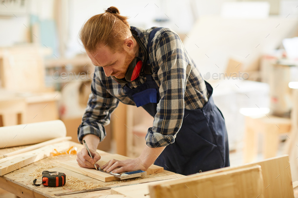 Contemporary Carpenter Working - Stock Photo - Images