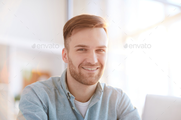 Portrait of Smiling Man in Office - Stock Photo - Images