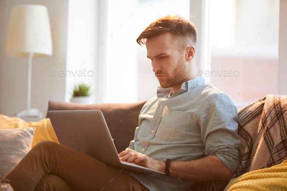 Handsome Man Using Laptop at Home - Stock Photo - Images