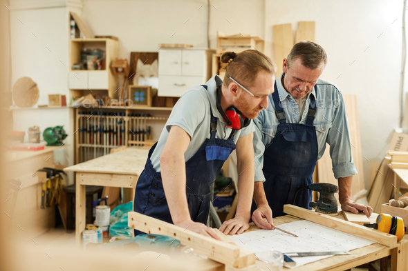 Father and Son in Carpentry - Stock Photo - Images