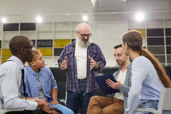 Smiling Senior Man Telling Story - Stock Photo - Images