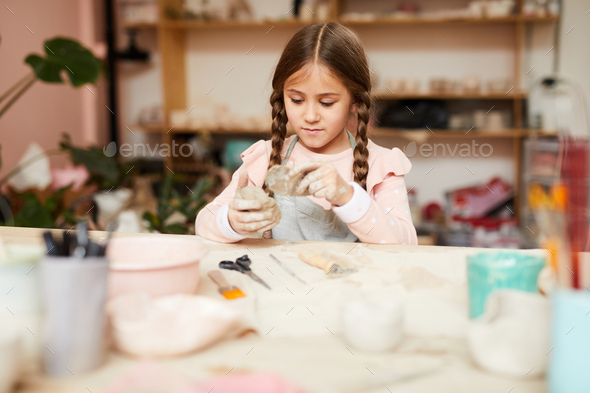 Cute Little Girl Shaping Clay - Stock Photo - Images