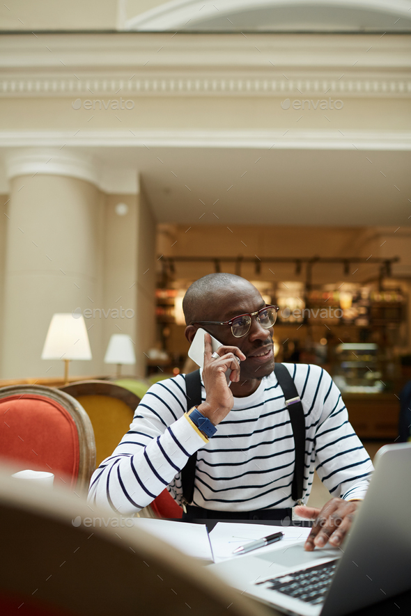 African Man Working in Cafe - Stock Photo - Images