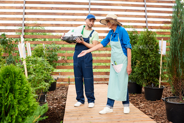 Two Workers in Garden - Stock Photo - Images