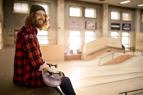 Skater Sitting on Ramp - Stock Photo - Images
