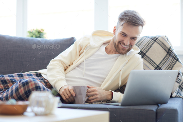 Young Man Lying on Sofa - Stock Photo - Images