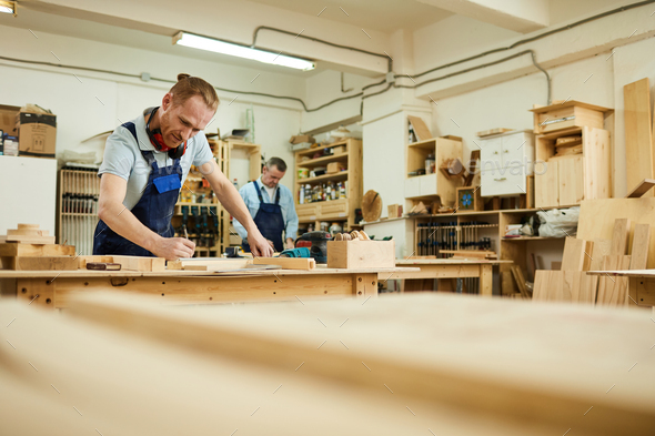 Carpenter Working in Joinery - Stock Photo - Images
