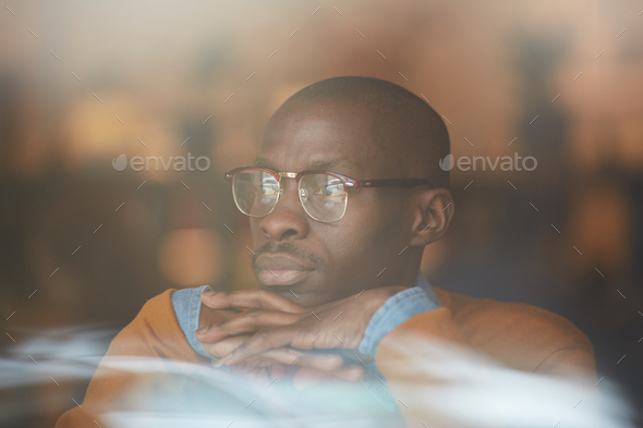 African Man Looking at Window in Cafe - Stock Photo - Images