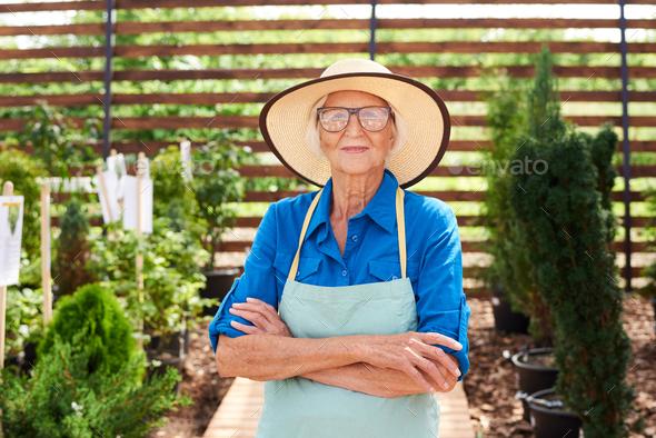 Senior Gardener Wearing Straw Hat - Stock Photo - Images