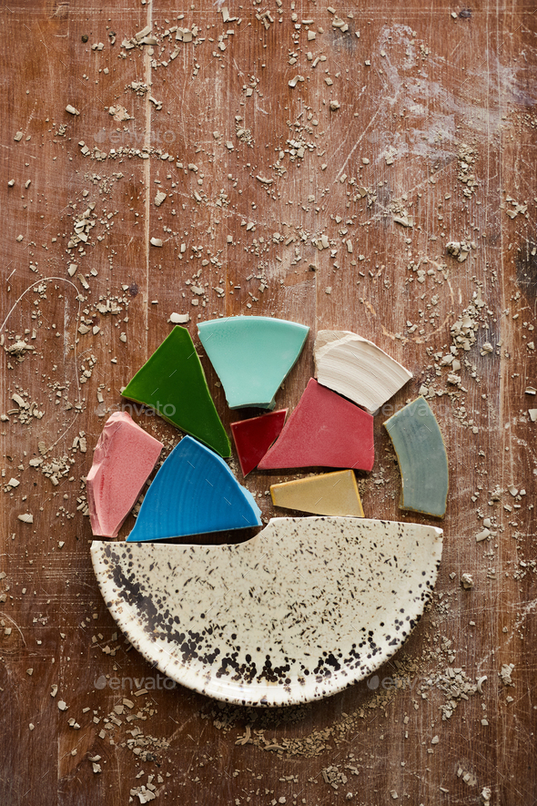 Puzzles of ceramic plate - Stock Photo - Images
