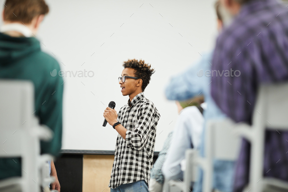 Young student presenting his startup project at conference - Stock Photo - Images