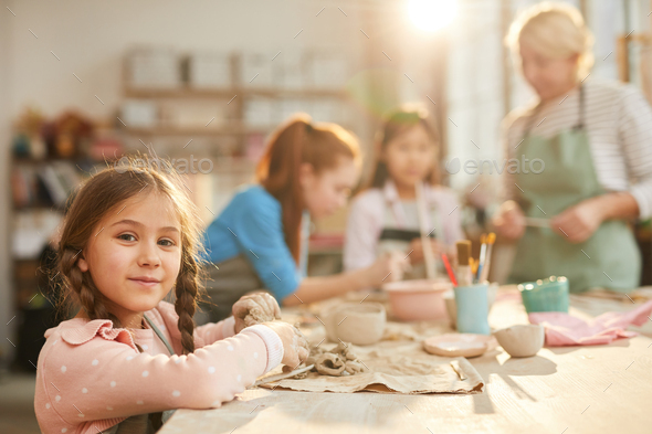 Cute Little Girl in Pottery Class - Stock Photo - Images