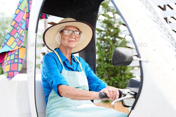 Senior Gardener Driving Car - Stock Photo - Images