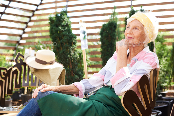 Pensive Senior Woman Resting in Garden - Stock Photo - Images