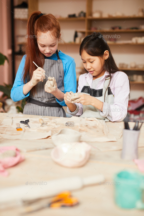 Two Girls in Pottery Workshop - Stock Photo - Images