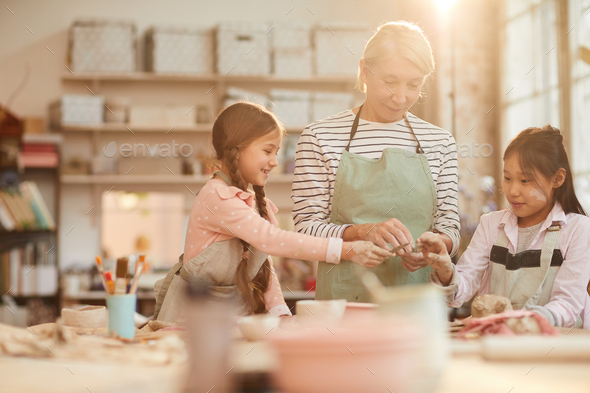 Cute Little Children in Pottery Workshop - Stock Photo - Images