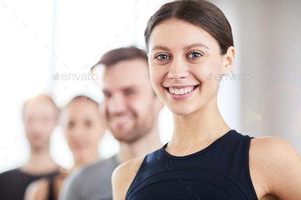 Smiling teenage gymnast - Stock Photo - Images