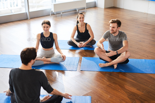 Yoga students at workshop with yogis - Stock Photo - Images