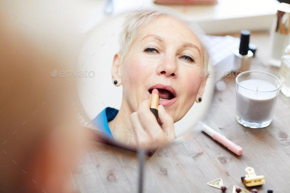 Applying lipstick - Stock Photo - Images