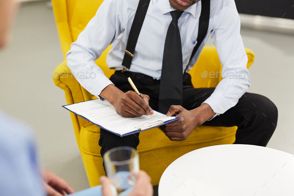 Male Psychologist Writing on Clipboard - Stock Photo - Images