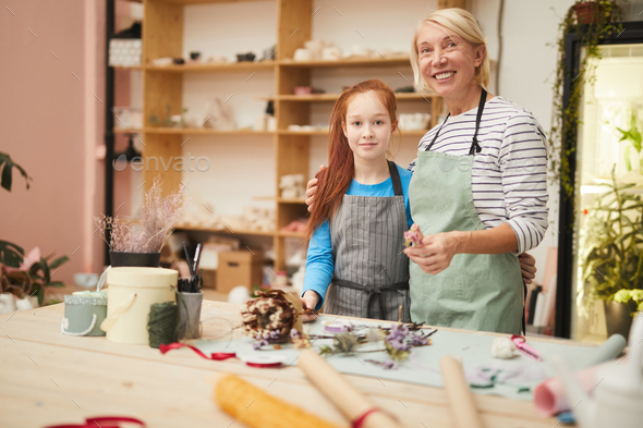 Female Florist Posing with Teenage Girl - Stock Photo - Images