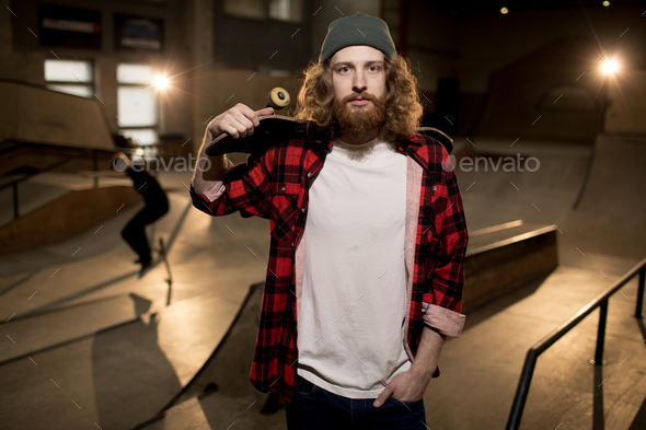 Bearded Skater Posing in Extreme Park - Stock Photo - Images