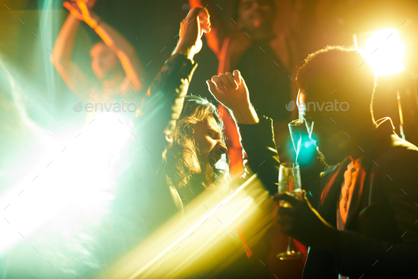 Emotional man dancing and singing at party - Stock Photo - Images