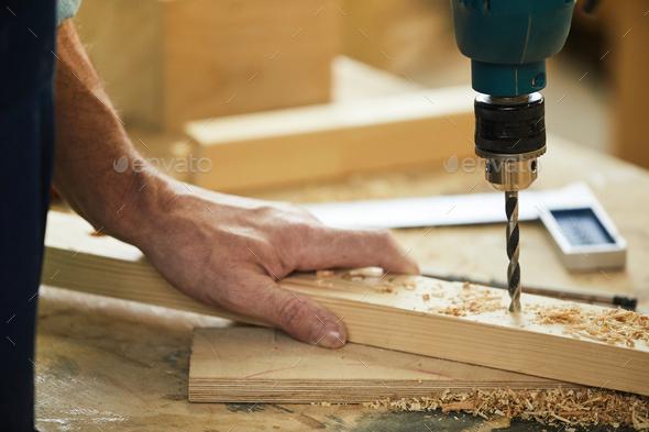Carpenter Drilling Wood Closeup - Stock Photo - Images