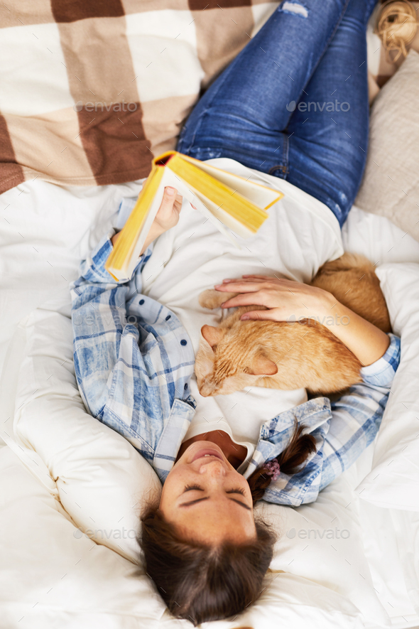 Above View Happy Woman Cuddling with Cat - Stock Photo - Images