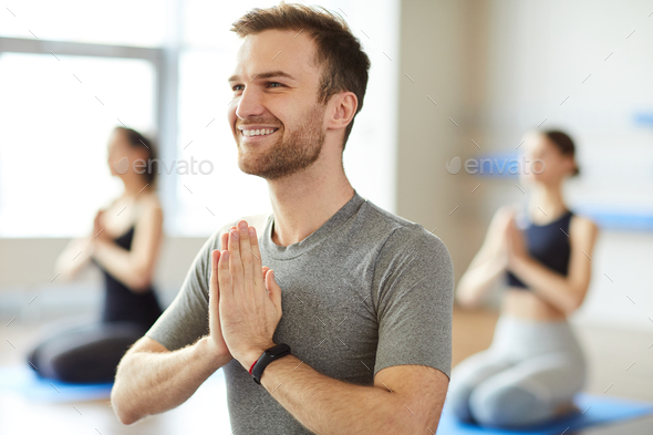 Happy man enjoying meditation - Stock Photo - Images