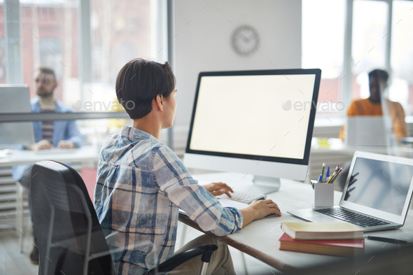Working in front of monitor - Stock Photo - Images