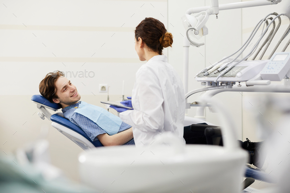 Young Man Consulting Dentist - Stock Photo - Images