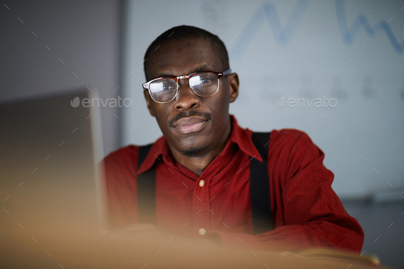 African Businessman Posing in Dark Office - Stock Photo - Images