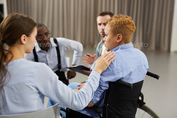 Woman in Wheelchair Attending Support Meeting - Stock Photo - Images