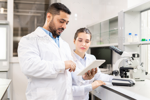 Examining test solution on tablet - Stock Photo - Images
