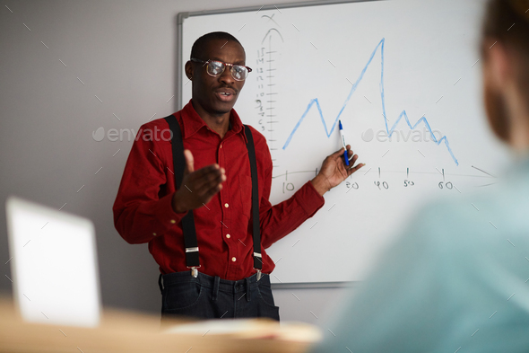 African Businessman Giving Presentation - Stock Photo - Images