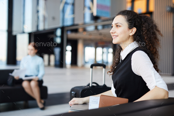 Young Businesswoman in Airport - Stock Photo - Images