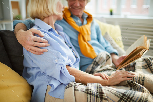 Loving Mature Couple Reading Book - Stock Photo - Images