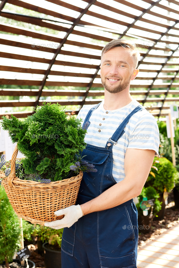 Smiling Worker in Garden - Stock Photo - Images