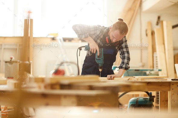 Modern Carpenter Drilling Wood - Stock Photo - Images