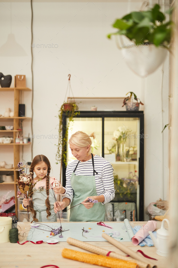 Cute Little Girl in Florists Workshop - Stock Photo - Images