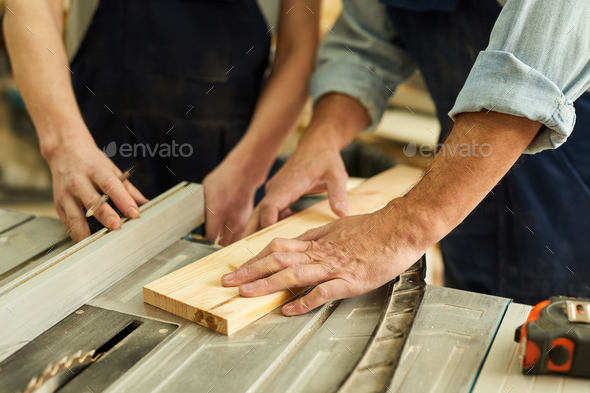 Carpenters Cutting Wood Closeup - Stock Photo - Images