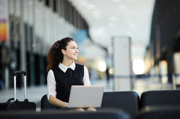 Tourist Using Laptop in Airport - Stock Photo - Images