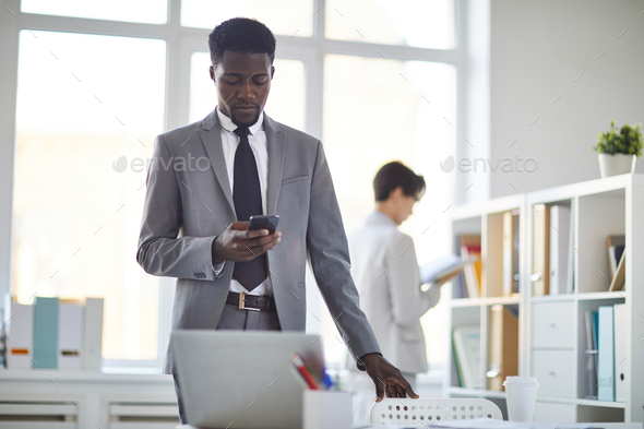 Employee with smartphone - Stock Photo - Images