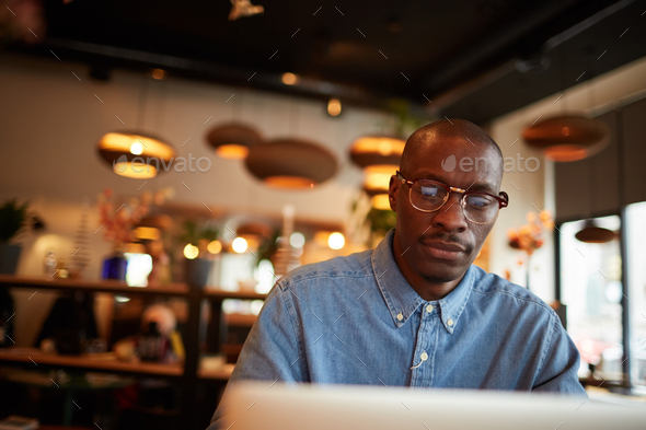 African Businessman Looking at Screen - Stock Photo - Images
