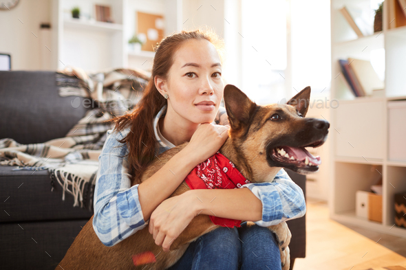 Asian Woman Posing with Dog - Stock Photo - Images